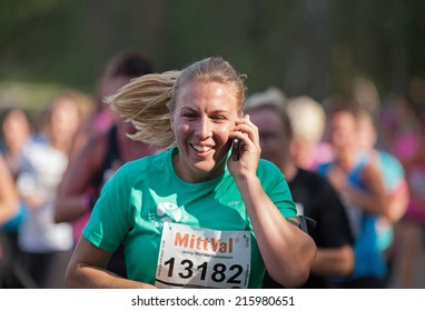 STOCKHOLM, SWEDEN - SEPTEMBER 06 2014: TJEJMILEN.  A running race each year in Stockholm with only female participants. Jenny Wallden Gustafsson.