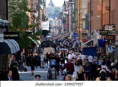 Stockholm, Sweden - September 10, 2009: View of people at the shopping pedestrian street Drottninggatan in the downtown district