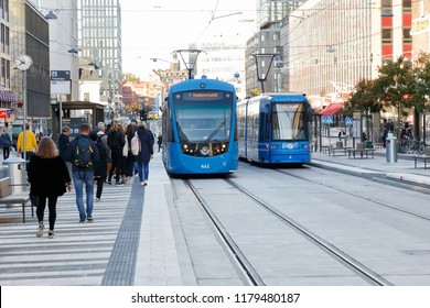 Stockholm, Sweden - September 13, 2018: Two blue modern trams in service for SL on line 7 has stoped at the tram stop T-Centralen located in the Klarabergsgatan street in downtown Stockholm.