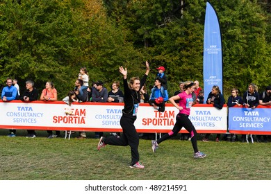 Stockholm, Sweden - September 24, 2016: Happy woman raising her hands as she crosses the finish line in the race, TCS Lidingoloppet, 15 km