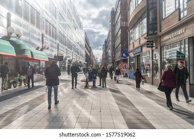 Stockholm, Sweden - September 24, 2019: View of Drottninggatan pedestrian street at sunny day.