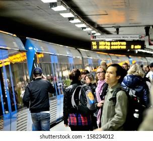 STOCKHOLM, SWEDEN - SEPTEMBER 27 Subway train passengers crowding to get on and off station platform T-centralen, the hub of the Stockholm SL transportation system in Stockholm on September 27, 2013.
