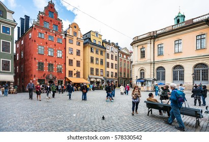 STOCKHOLM, SWEDEN - SEPTEMBER 8, 2011: tourists on oldest medieval Stortorget square in Stockholm city. The town in stone started to be erected around thiis historical central square from 1400 years