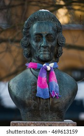 As Stockholm temperatures descend to below zero, an unknown yarn bomber has clothed a sculpture of Emanuel Swedenborg with a knitted scarf. Captured in Maria Square (Mariatorget), Stockholm.