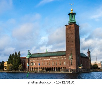 Stockholm Town Hall (Stockholms Stadshus). A huge town hall with a very high tower, the building is made of bricks, from this place is a very nice view on Gamla Stan.