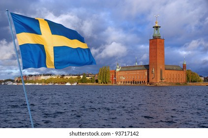 Stockholm. View of City Hall from the Lake Mclaren  with flag