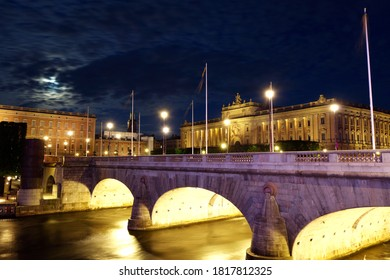 STOCKHOLM/SWEDEN - JULY 07, 2019: Stockholm, Night time, water flowing under bridges leading to the Old Town