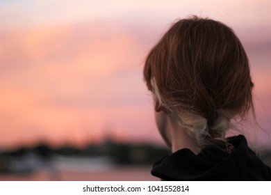 Stockholm/Sweden:23.07.2016: Woman with braid is watching sunset in Stockholm