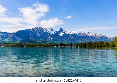 Stockhorn of Bernese Alps with lake Thun looking from street in village, Berne, Switzerland ( panorama )