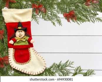 Stocking Befana And Christmas Decorations On Wooden White Background