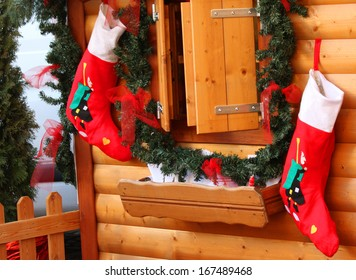 The Stockings Of Befana In Wooden Wall Hanging Waiting For Epiphany