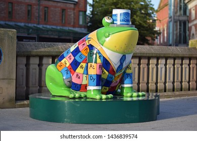 Stockport, Cheshire, UK. June 28, 2019. Chemit the frog. Celebration of the international year of the periodic table IYPT  with a model of  a frog wearing a waistcoat with a periodic table pattern.