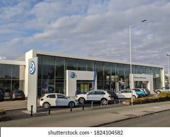 Stockport, Greater Manchester, UK. September 29, 2020. Volkswagen Inchcape car dealership with cars parked on forecourt.