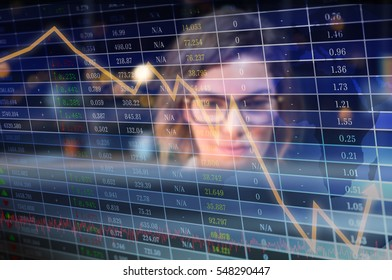 Stocks and shares against businesswoman sitting in office