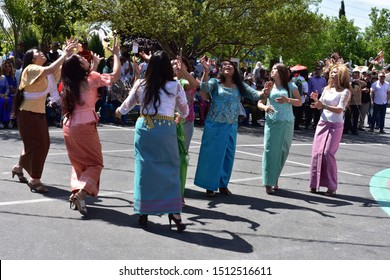 Stockton, CA (April 13, 2019)- A group of Cambodian women in traditional dress plays traditional game during the Cambodian New Year celebration at Stockton Cambodian Buddhist Temple (Wat Dhammararam).