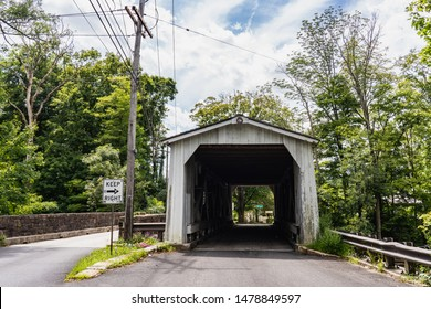 Stockton, New Jersey - Aug. 10, 2019: Green Sergeant's Covered Bridge over the Wickecheoke Creek in Delaware Township, Hunterdon County is the last historic covered bridge in the state of New Jersey