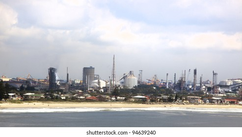 stockton showing the beach and industry behind it
