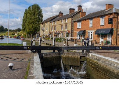 Stoke Bruerne, England, September 2018 - View across canal lock to The Canal Museum at Stoke Bruerne on the Grand Union Canal, a popular historic visitors destination Northampton