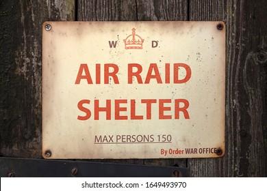 STOKE BRUERNE, NORTHAMPTONSHIRE, UK - 05/10/2019:  World War 2 sign for Air Raid Shelter on door
