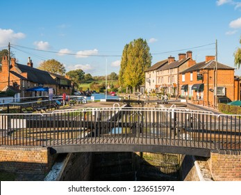 Stoke Bruerne UK October 31 2018: canal river with moored boats and shop around it in village in northamptonshire, england