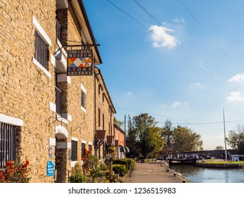 Stoke Bruerne UK October 31 2018: canal museum logo next to canal river in village in northamptonshire, england