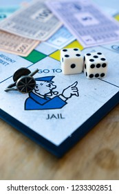 Stoke on Trent, Staffordshire - 18th November 2018 - A diagnoal view of the Monopoly board and a player landing on the Go to Jail square, dice rolling board game, shot with a macro lens