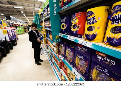 Stoke on Trent, Staffordshire - 18th January 2018 - A young handsome school boy with ADHD, Autism, Aspergers syndrome looks, browses at some Easter eggs in the local Tesco extra supermarket store, sho