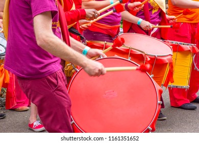 Stoke on Trent,Staffordshire/Uk-06.24.2017:Drummers wearing colourful clothes on Lgbt pride event in Hanley park warming up festive atmosphere with rhythm.
