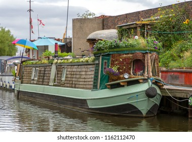 STOKE-ON-TRENT, STAFFORDSHIRE, UK - AUGUST 6 , 2018: A waterside view of Stoke, in the former industrial heartland of England, seen from a narrowboat on the Staffordshire and Warwickshire canal .