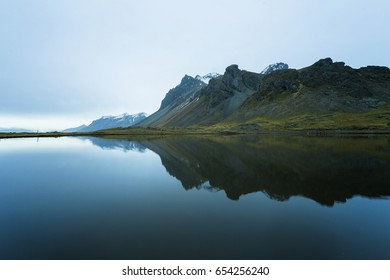 Stokkness mountain at Iceland with reflection lake