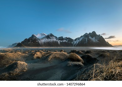 Stokksnes cape and Vestrahorn Mountain during sunset. Eastern Iceland landscape.