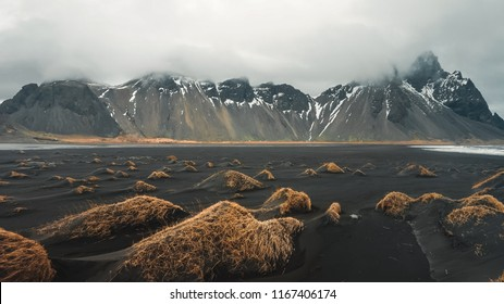 Stokksnes cape and Vestrahorn Mountain. Landscape with popular tourist attraction in Iceland. Exciting excursion to the sights view in winter