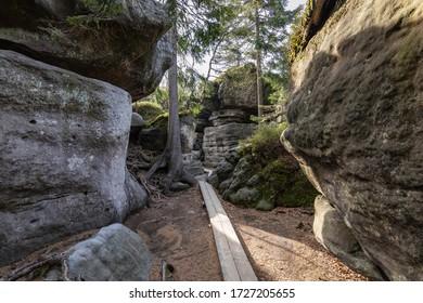 Stolowe Mountains National Park. Wooden boardwalk in Rock Labyrinth hiking trail Bledne Skaly near Kudowa-Zdroj, Lower Silesia, Poland.  - Shutterstock ID 1727205655