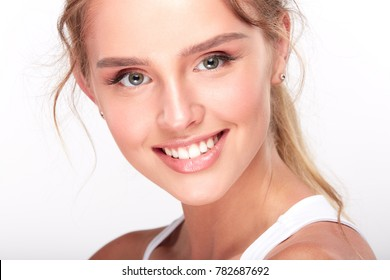 Stomatology concept, girl with strong white teeth looking at camera and smiling. Closeup of young woman at dentist's, studio, indoors