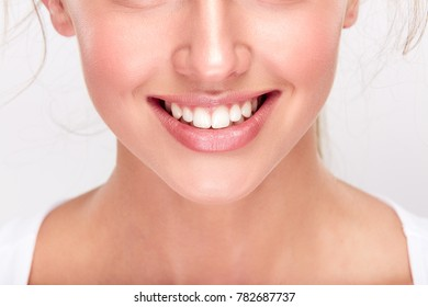 Stomatology concept, lower part of girl's face with strong white teeth. Woman's snow-white smile, closeup. Woman at dentist's, studio, indoors