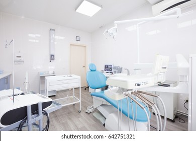 Stomatology interior of dental clinic with professional chair. Dentistry, medicine, medical equipment and stomatology concept