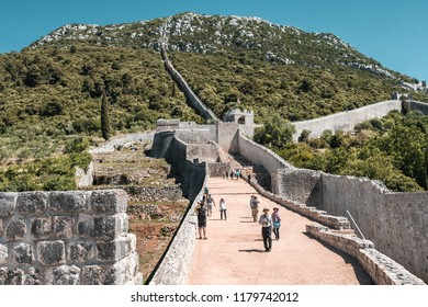 Ston, Croatia - July 25 2017: The second longest city wall in the world, after the Great Wall of China. One of the major tourist attractions in Southern Croatia.