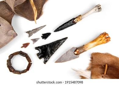 Stone Age Tools on white Background - Stone Age Knives and Obsidian Arrows