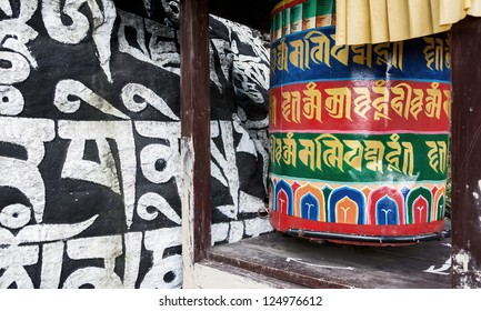 The stone along trek on which  ancient buddhist texts and the prayer cylinder - Everest region, Nepal, Himalayas