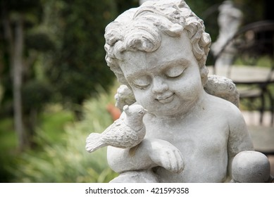Stone angel with wings and bird