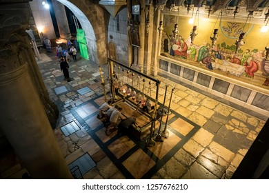 The Stone of the Anointing, The Stone of Unction in Church of the Resurrection, Old City of JERUSALEM, ISRAEL. 24 October 2018