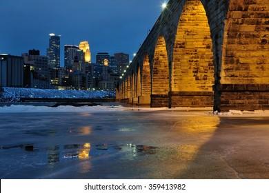 Stone Arch Bridge and Minneapolis Skyline at Night