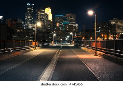 Stone Arch Bridge at Night - downtown Minneapolis in background
