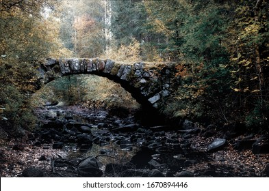 Stone arch bridge over a dry river bed in Sweden