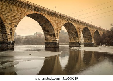 Stone Arch Bridge Over the Mississippi River in Winter - Downtown Minneapolis.