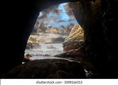 Stone arch linking Pacific Ocean to interior of  Devil's Punchbowl,  Newport, Oregon