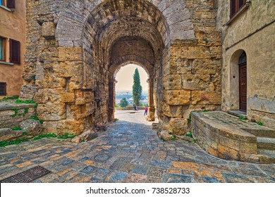 stone arch in street of Volterra, Italy