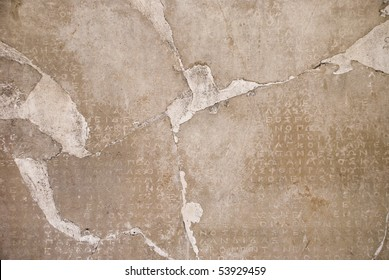 Stone background with antique Greek inscriptions