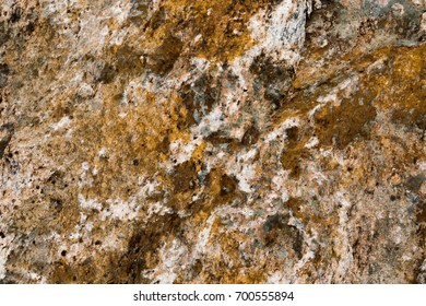 Stone background, rock wall backdrop with rough texture