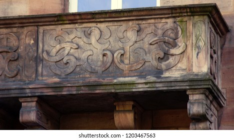The stone balcony is decorated around the perimeter with carved Arabesque